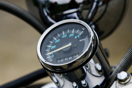 Vintage speedometer and gasoline level indicator on an expensive scooter