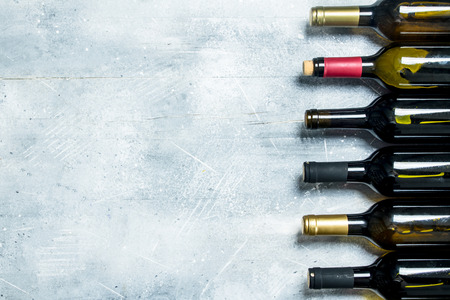 Wine background. Bottles of red and white wine. On a rustic background. Stok Fotoğraf