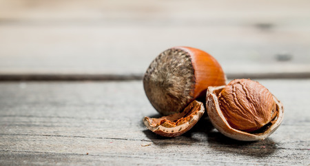 Hazelnut with shell . On a wooden background.