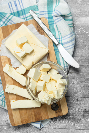 Butter with a napkin. On a rustic background. Imagens
