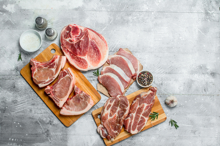 variety of raw meat pork. On a rustic background.