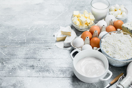 Different types of dairy products. On a rustic background.