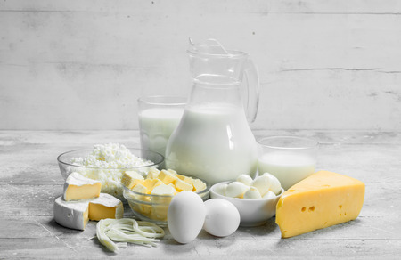 variety of fresh dairy products. On a rustic background.