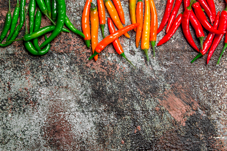 Fragrant hot pepper. On rustic background