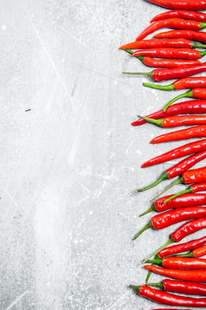 Fresh red hot pepper. On white rustic background Banco de Imagens