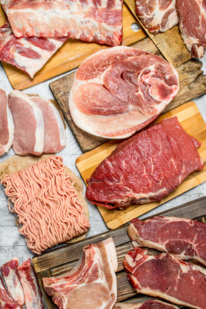 Raw meat. The various meats of pork and beef. On a rustic background.