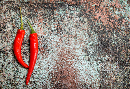 Red hot pepper. On rustic background