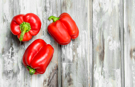 Fragrant ripe red pepper. On wooden background Banque d'images - 120904458