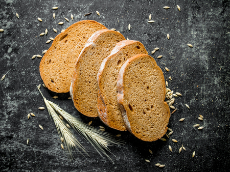 Fragrant rye bread with spikelets. On dark rustic background