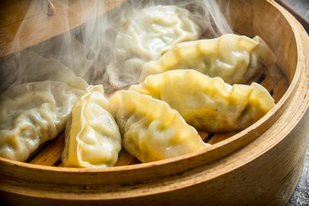 Hot Chinese dumplings gedza in the steamer. Traditional dish Zdjęcie Seryjne
