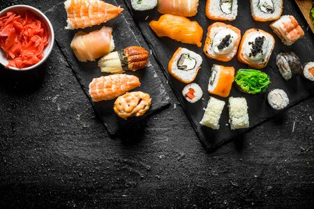 Set of traditional Japanese food. On black rustic background