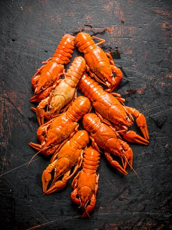 Spicy boiled crayfish. On dark rustic background Stok Fotoğraf