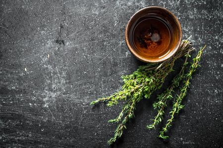Fresh herbs. Thyme. On dark rustic background