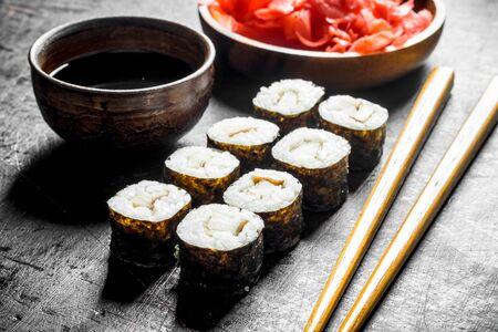 Fresh rolls with smoked chicken. On dark rustic background