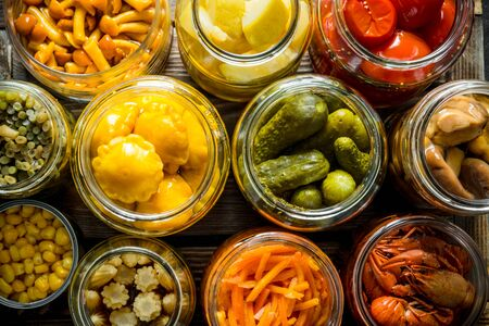 Preserved food in glass jars. Top view Banque d'images - 124763558