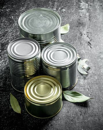 Closed cans of canned food. On dark rustic background Imagens - 124763688