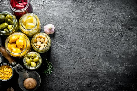 Preserved home grown vegetables. On black rustic background Imagens - 124763717