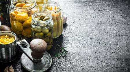 Preserved home grown vegetables. On black rustic background Banco de Imagens