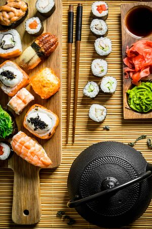 Traditional Japanese sushi, maki and rolls on a napkin. On rustic background