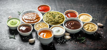 Mix from different kinds of sauces. On dark rustic background Stock fotó
