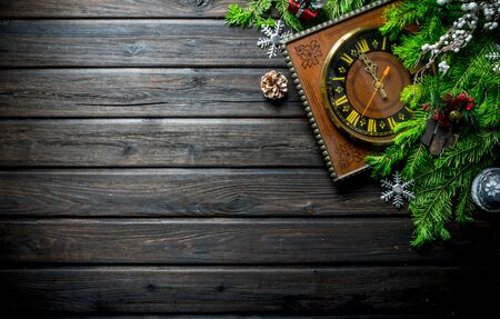 New year's clock one minute to midnight. On rustic background