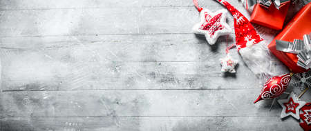 Christmas decorations with gift boxes. On white rustic background