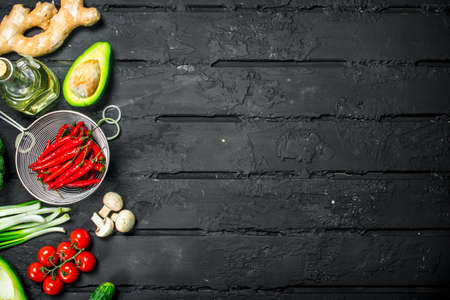 Organic food. Different healthy vegetables . On a black rustic background.