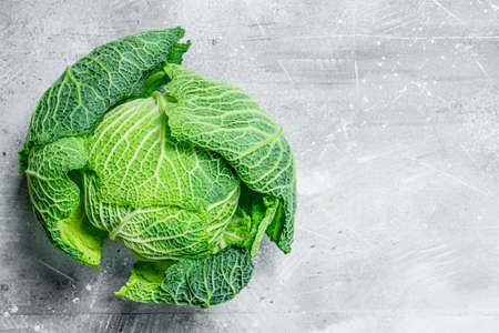 Savoy cabbage . On rustic background