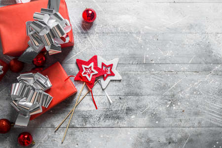 Gift boxes with Christmas toys. On white rustic background Zdjęcie Seryjne
