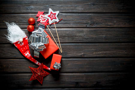 Christmas composition of red gift boxes and Christmas decorations. On a dark wooden background Zdjęcie Seryjne