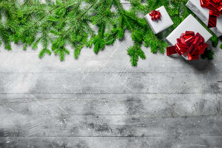 Collection of Christmas gift boxes with fir branches. On white rustic background