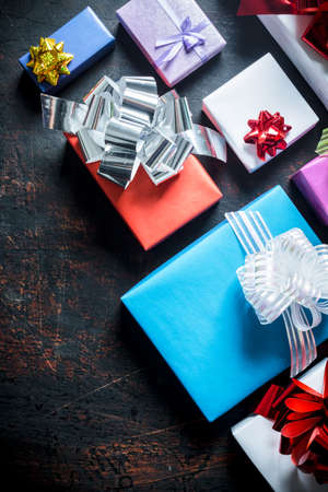 Various Christmas gift boxes. On a dark rustic background