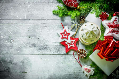 Christmas candlestick with gift boxes and fir branches. On white rustic background Zdjęcie Seryjne