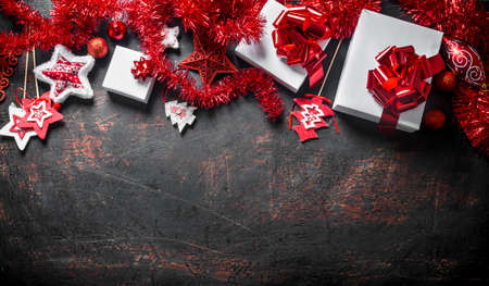 Various Christmas decorations and gifts. On a dark rustic background