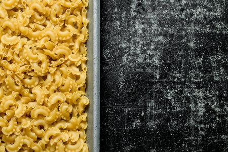 Dry paste. Texture pasta. On black rustic background Zdjęcie Seryjne