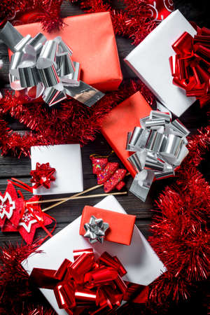 Composition of Christmas gift boxes and decorations. On a dark wooden background Zdjęcie Seryjne