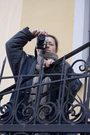 Female with camera photografing something  Stock Photo