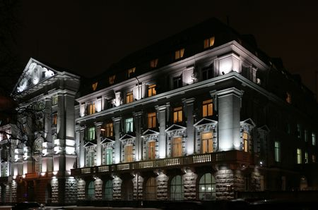 Lighting facade of goverment building at evening and its windows different color of light. photo