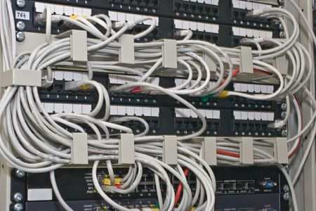 distribution panel in rack with routers and switches