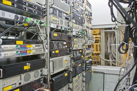 colocation: Racks with servers and routers Stock Photo