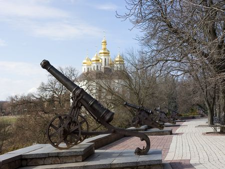 Old cannones in Chernigov. On background sky and cossacks church. Stock Photo