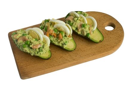 forcemeat: Forcemeat fruits of an avocado with millet, a green peas, eggs and a red fish