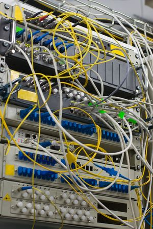 telco: fiber connection of router and server in rack Stock Photo