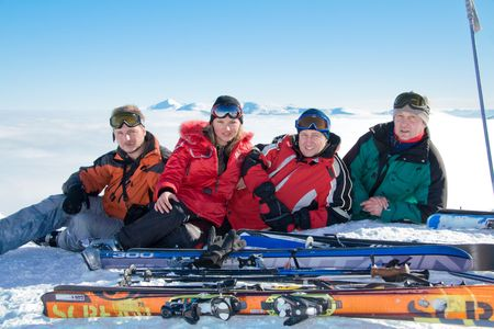 Group of skiers on the top of Stig mountain. On background Goverla is highest mountain of Ukraine. Stock Photo