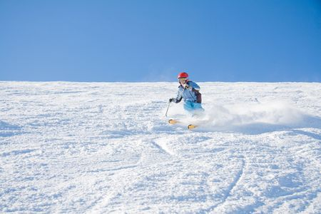 Young girl have a fun skiing on slope of mountain Stig