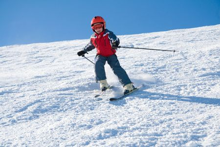 Young skirider on slope of mountain Stig Stock Photo