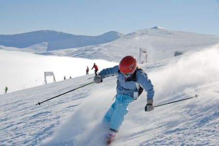 Girl skiing from the top mountain Stig