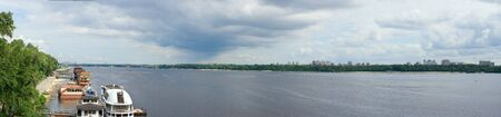 View to left side of river Dnipro in Kyiv (capital city of Ukraine). On  Metro bridge