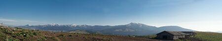 The highest mountains of ukrainian Carpathian is Chorhogora ridge from old farm on slope of moutain Radul. From left to right mountains: Hoverla, Pozhizhevska, Turkul, Hutyn Tomnatek, Brebeneskul, Minchel, Dzembronya, Smotrych, Pip Ivan (on top is old pol