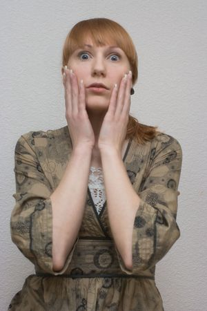 Young lady seeing to camera with astonishment Stock Photo